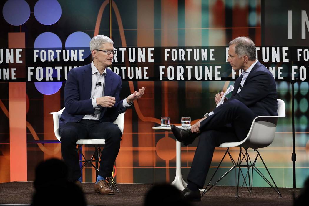 Apple CEO Tim Cook, left, talks with Adam Lashinsky, executive editor of Fortune, during The Fortune CEO Initiative 2018 Annual Meeting, Monday, June 25, 2018, in San Francisco. (Marcio Jose Sanch ...