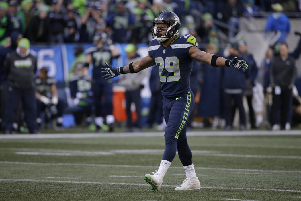 Seattle Seahawks free safety Earl Thomas walks on the field during the first half of an NFL football game against the Arizona Cardinals, Sunday, Dec. 31, 2017, in Seattle. (AP Photo/John Froschauer)