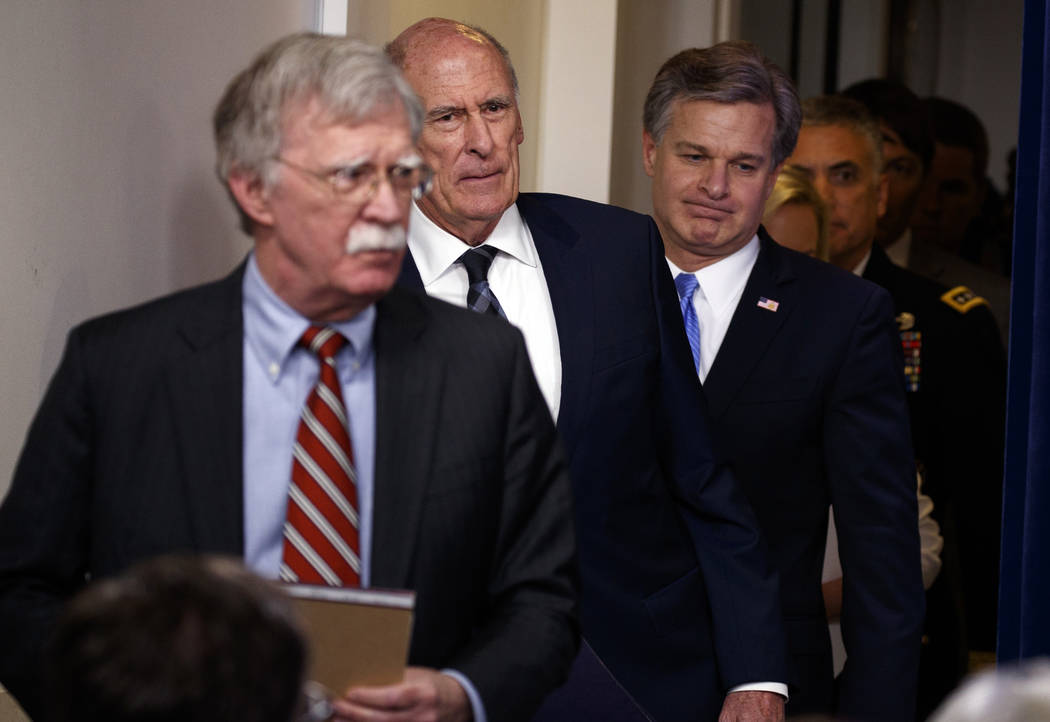 Director of National Intelligence Dan Coats arrives for the daily press briefing at the White House, Thursday, Aug. 2, 2018, in Washington. From left, National Security Adviser John Bolton, Coats, ...