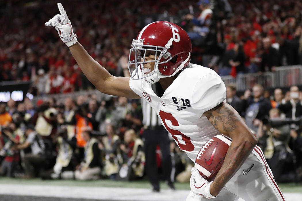 Alabama wide receiver DeVonta Smith (6) celebrates his touchdown during overtime of the NCAA college football playoff championship game against Georgia, Monday, Jan. 8, 2018, in Atlanta. Alabama w ...