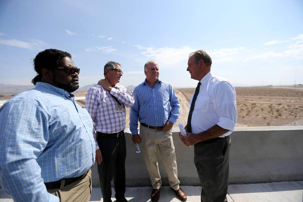 North Las Vegas Mayor John Lee, right, visits with, from left, Senior Engineer Tom Brady, Engineering and Construction Services Division Manager Dale Daffern and Chief Financial Officer Darren Ada ...