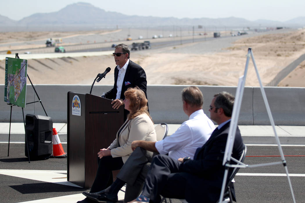 CBRE Executive Vice President Kevin Higgins speaks during a ceremony marking the opening of Tropical Parkway connector to the Interstate 15 and the Las Vegas Beltway in North Las Vegas Thursday, A ...