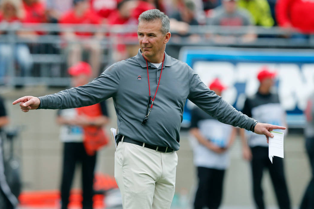 FILE - In this April 14, 2018, file photo, Ohio State head coach Urban Meyer watches his team's NCAA college spring football game in Columbus, Ohio. (AP Photo/Jay LaPrete, File)