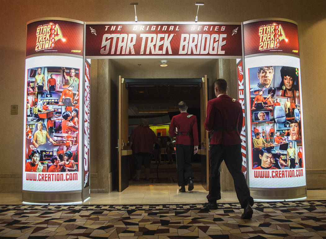 "Attendees walk into ""The Original Series Star Trek Bridge"" exhibit at the Star Trek convention on Thursday, Aug. 2, 2018, at the Rio, in Las Vegas. Benjamin Hager Las Vegas Review-Journa ..."