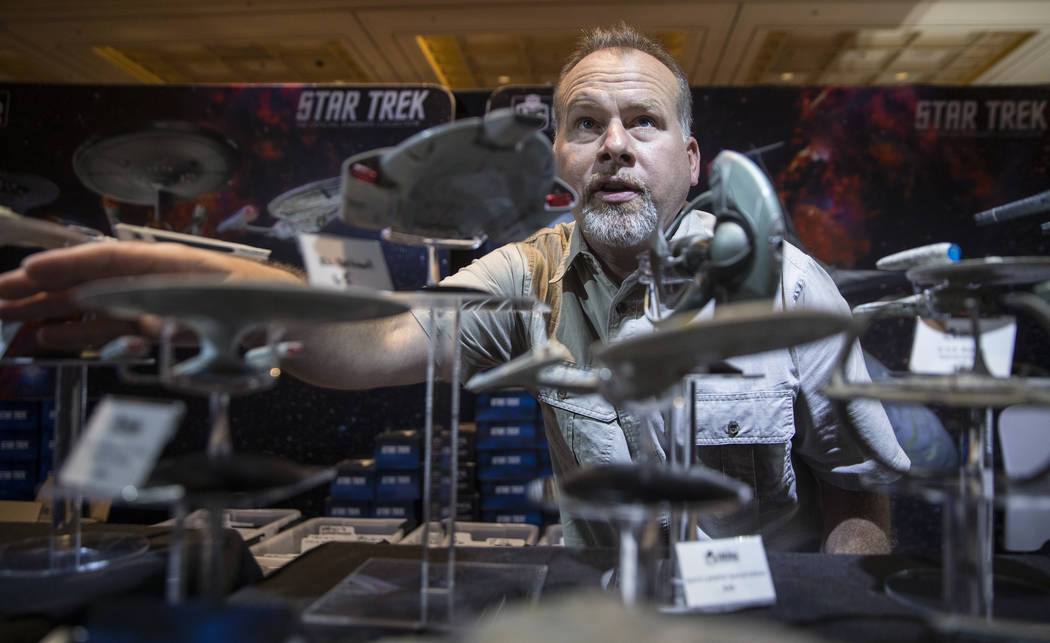 Nils Walter, a sales person with Eaglemoss, points out features of collectable Star Trek ships on Thursday, Aug. 2, 2018, at the Star Trek convention, at the Rio, in Las Vegas. Benjamin Hager Las ...