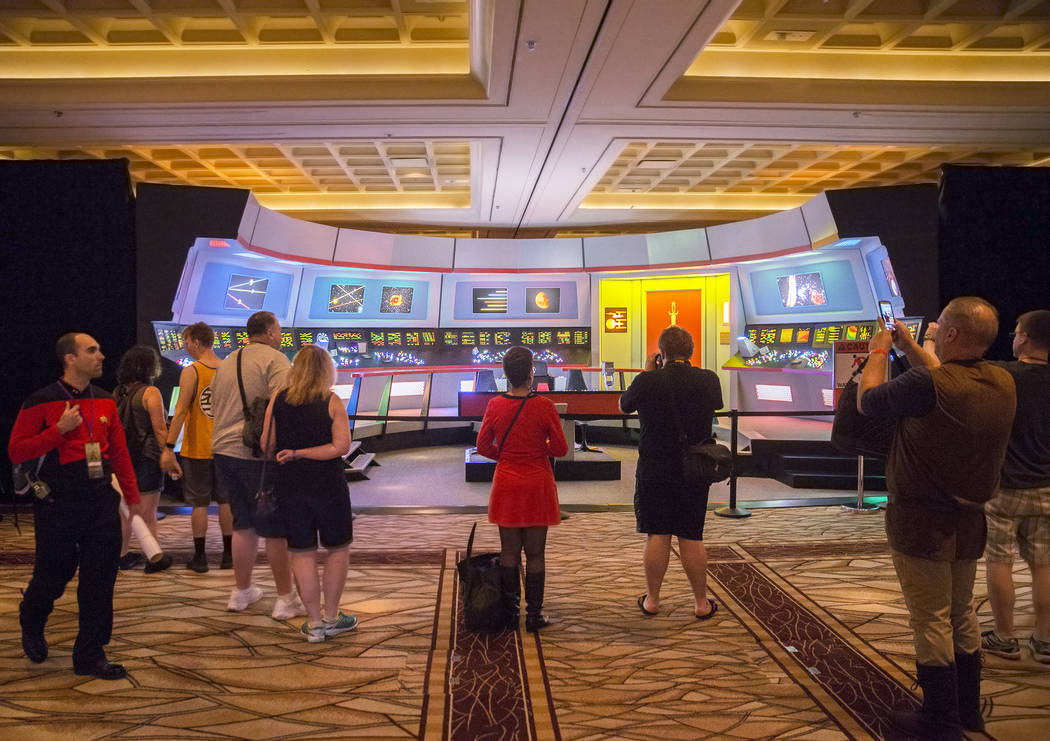Attendees explore the original Star Trek bridge on Thursday, Aug. 2, 2018, at the Star Trek convention, at the Rio, in Las Vegas. Benjamin Hager Las Vegas Review-Journal @benjaminhphoto