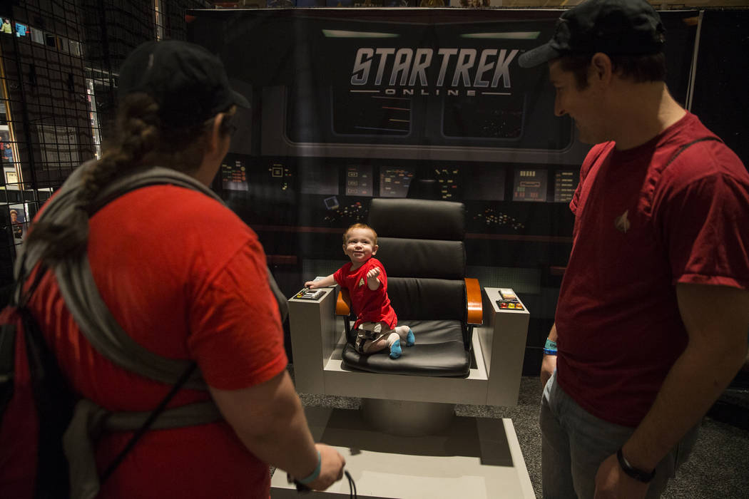 Malachi Beadles, 1, middle, explores the Star Trek Online booth at the Star Trek convention on Thursday, Aug. 2, 2018, at the Rio, in Las Vegas. Benjamin Hager Las Vegas Review-Journal @benjaminhphoto
