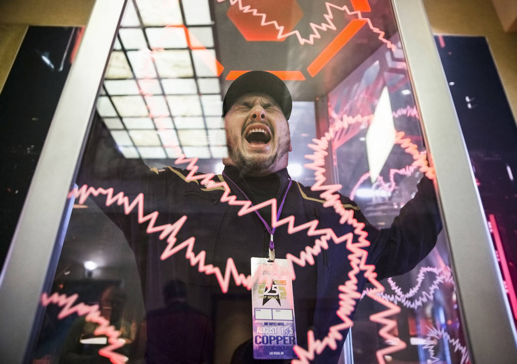 "Stephan Waldrep, from Kingsport, Tenn., takes a photo in a replica of the ""Agonizer Booth"" at the Star Trek convention on Thursday, Aug. 2, 2018, at the Rio, in Las Vegas. Benjamin Hager ..."