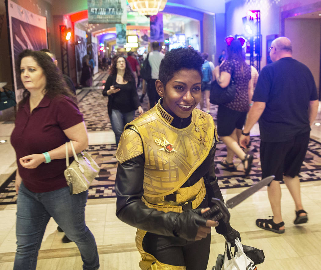 Mahogany Harris, from Ottawa, Canada, dressed as Michael Burnham from Star Trek: Discovery, walks the halls at the Star Trek convention on Thursday, Aug. 2, 2018, at the Rio, in Las Vegas. Benjami ...