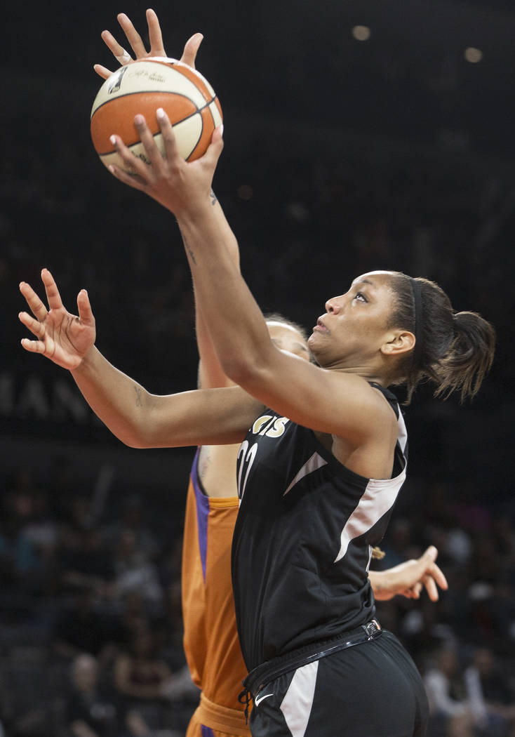 Aces center A'ja Wilson (22) drives past Phoenix Mercury center Brittney Griner (42) in the second quarter on Wednesday, August, 1, 2018, at the Mandalay Bay Events Center, in Las Vegas. Benjamin ...