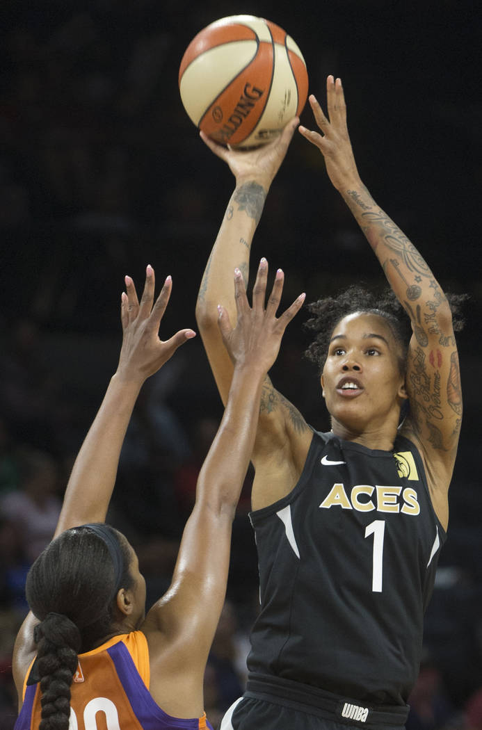 Aces forward Tamera Young (1) shoots a jump shot over Phoenix Mercury forward Camille Little (20) in the second quarter on Wednesday, August, 1, 2018, at the Mandalay Bay Events Center, in Las Veg ...