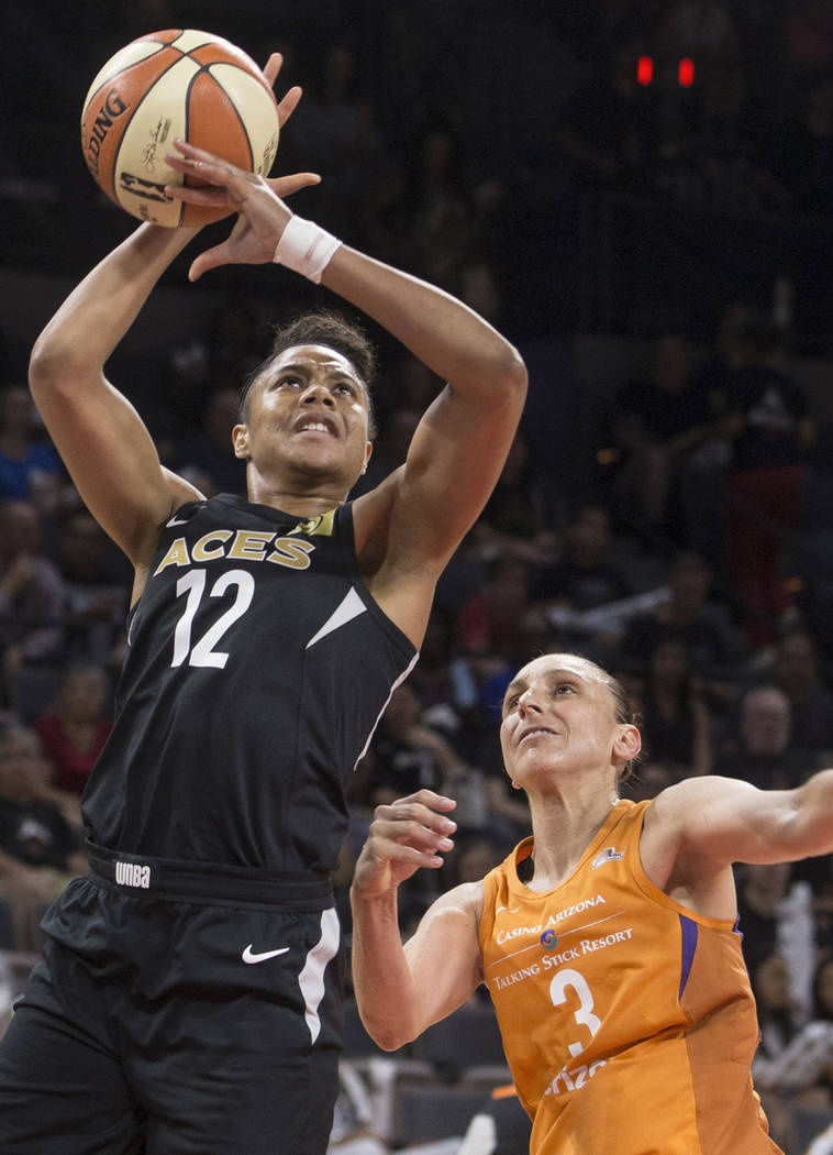 Aces forward Nia Coffey (12) gets fouled by Phoenix Mercury guard Diana Taurasi (3) in the second quarter on Wednesday, August, 1, 2018, at the Mandalay Bay Events Center, in Las Vegas. Benjamin H ...