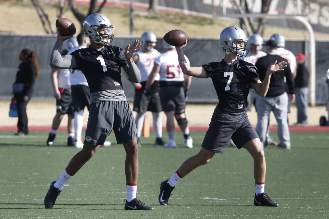 UNLV quarterbacks Kenyon Oblad (7) and Armani Rogers (1) prepare to throw the ball during the first day of spring practice on Tuesday, March 6, 2018, in Las Vegas. Bizuayehu Tesfaye/Las Vegas Revi ...