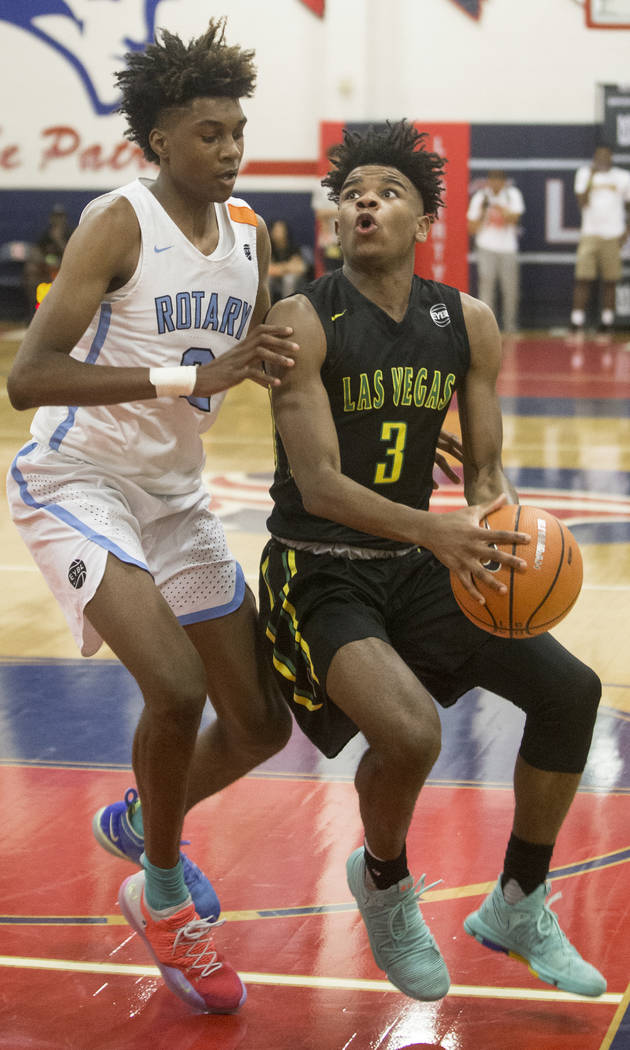 Las Vegas Prospects point guard Jaden Hardy (3) drives past Seattle Rotary forward Jaden McDaniels (2) in the first half during the Made Hoops Summer Showcase on Wednesday, July 25, 2018, at Liber ...