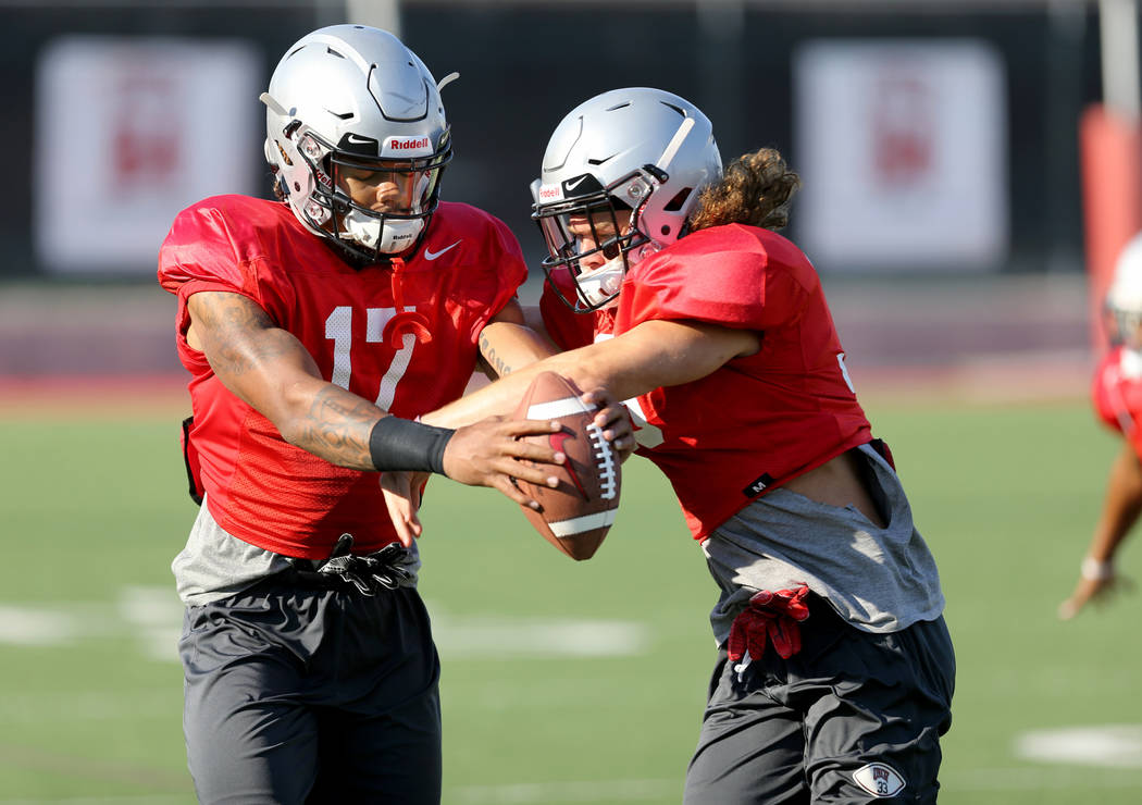 UNLV strong safety Evan Austrie (17) with teammate Dalton Baker (33) during practice at Rebel Park on the UNLV campus Monday, Aug. 6, 2018. K.M. Cannon Las Vegas Review-Journal @KMCannonPhoto