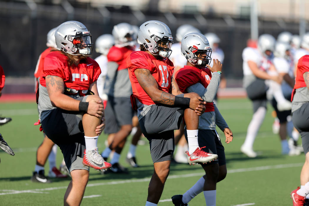 UNLV strong safety Evan Austrie (17), center, during practice at Rebel Park on the UNLV campus Monday, Aug. 6, 2018. K.M. Cannon Las Vegas Review-Journal @KMCannonPhoto