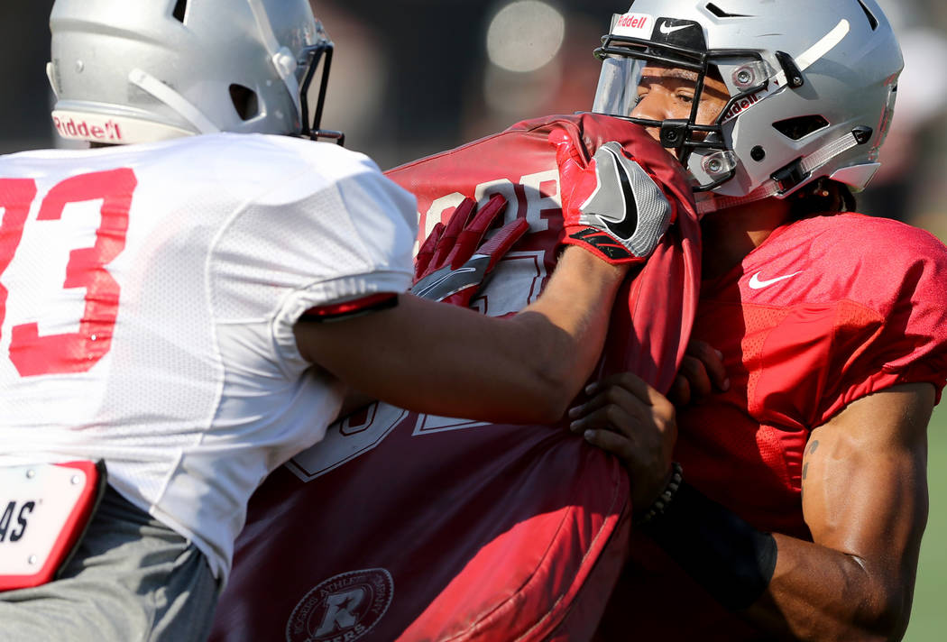 UNLV strong safety Evan Austrie (17), right, with teammate Adam Meyer (83) during practice at Rebel Park on the UNLV campus Monday, Aug. 6, 2018. K.M. Cannon Las Vegas Review-Journal @KMCannonPhoto