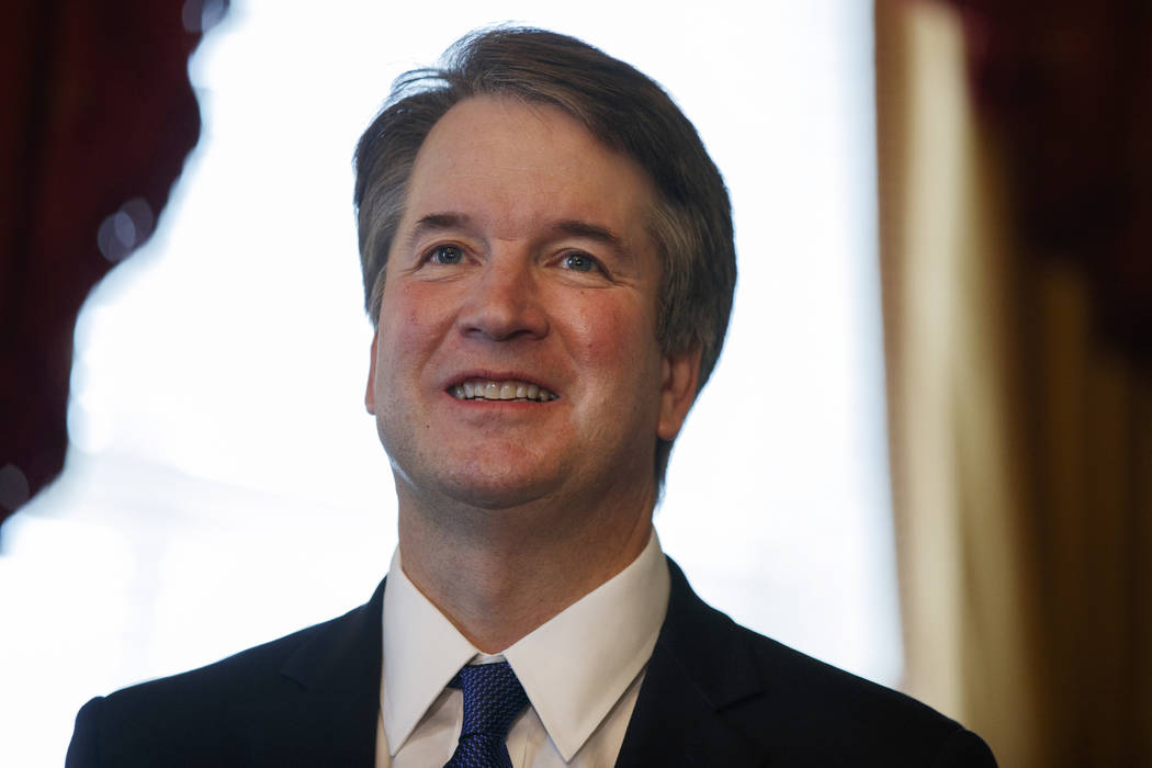 Supreme Court nominee Brett Kavanaugh smiles during a meeting with Sen. Orrin Hatch, R-Utah, on Capitol Hill, Wednesday, July 11, 2018, in Washington. (AP Photo/Evan Vucci)