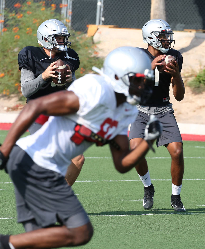 UNLV backup quarterback Max Gilliam, left, and quarterback Armani Rogers (1) prepare to throw the ball during team practice on Thursday, Aug. 9, 2018, in Las Vegas. Bizuayehu Tesfaye/Las Vegas Rev ...