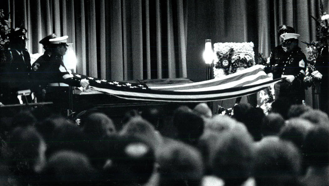 Members of the Marine Corps fold a flag over the casket of slain FBI Agent John Bailey at Palm Mortuary in 1990. (Las Vegas Review-Journal File Photo)