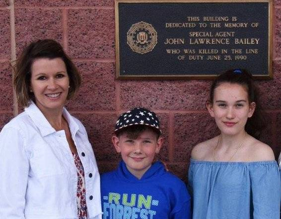 A photo of Special Agent John Bailey's daughter and grandchildren outside the FBI building in Las Vegas, which was named in his honor. (Federal Bureau of Investigation)