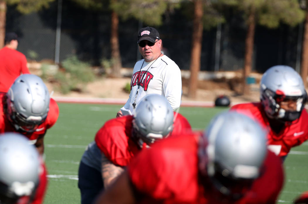 UNLV Rebels head coach Tony Sanchez watches his players during team practice on Thursday, Aug. 9, 2018, in Las Vegas. Bizuayehu Tesfaye/Las Vegas Review-Journal @bizutesfaye