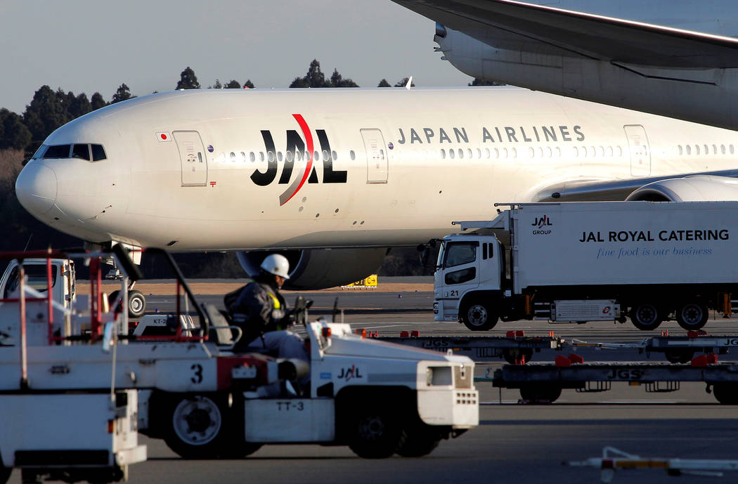 A Japan Airlines jet taxis on the runway at Narita International Airport in Narita, east of Tokyo, Wednesday, Jan. 13, 2010. (AP Photo/Itsuo Inouye)