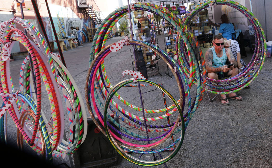 Greg Landers of Las Vegas and his son Lucky, 8, are seen through hula hoops created by Tape Pixie owner Emily Landers during First Friday Las Vegas, a monthly art festival, located in downtown Las ...