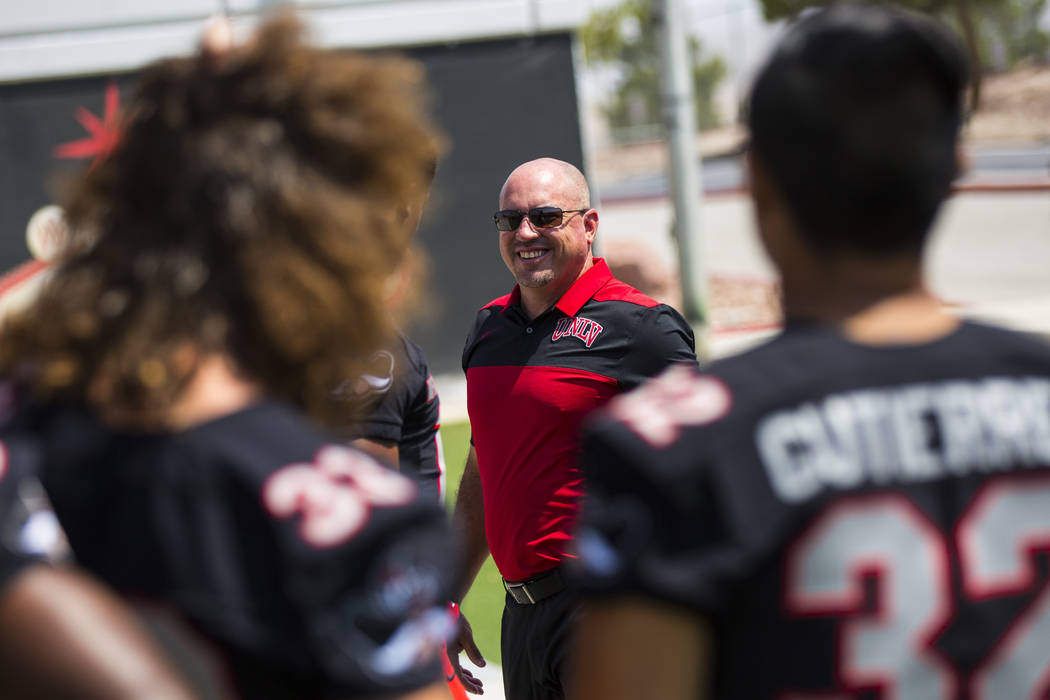 UNLV Rebels head coach Tony Sanchez watches his players line up during UNLV football's photo day at Sam Boyd Stadium in Las Vegas on Wednesday, Aug. 8, 2018. Chase Stevens Las Vegas Review-Journal ...