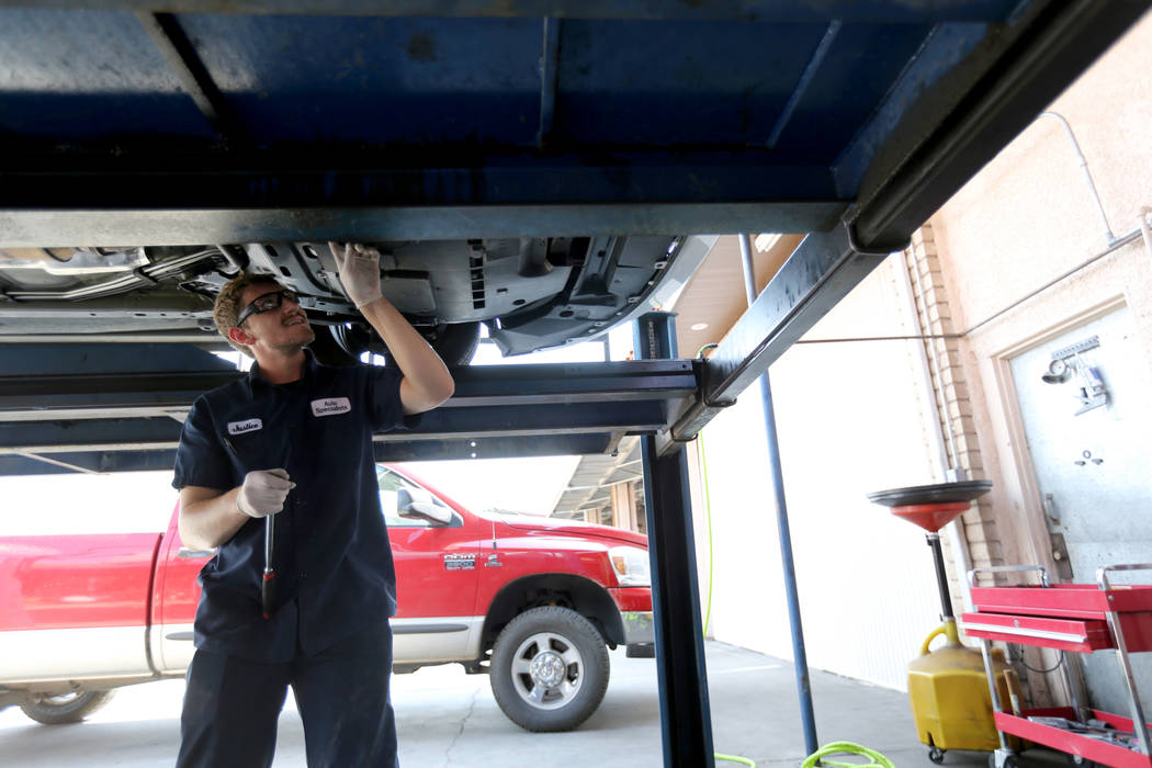 Lube technician Justice Erickson works on a car at Auto Specialists at 705 Juniper Way in Boulder City Wednesday, Aug. 1, 2018. K.M. Cannon Las Vegas Review-Journal @KMCannonPhoto