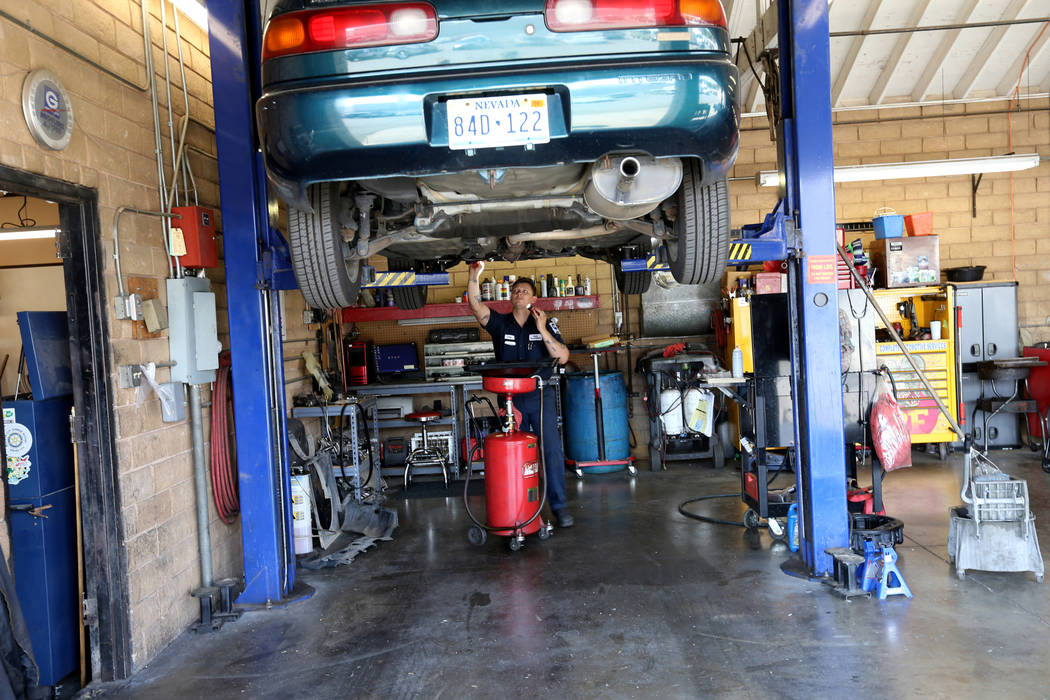 Mechanic Cody Surratt works on a car at Auto Specialists at 705 Juniper Way in Boulder City Wednesday, Aug. 1, 2018. K.M. Cannon Las Vegas Review-Journal @KMCannonPhoto