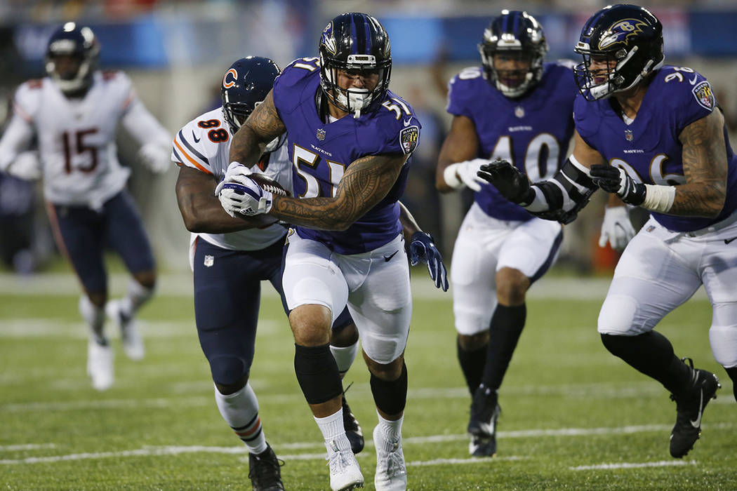 Baltimore Ravens linebacker Kamalei Correa (51) runs after an interception against the Chicago Bears during the first half at the Pro Football Hall of Fame NFL preseason game Thursday, Aug. 2, 201 ...