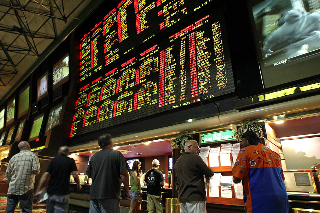 Bettors watch the NCAA Tournament boards at the Las Vegas Hilton (now the Westgate) in 2011. (Las Vegas Review-Journal)