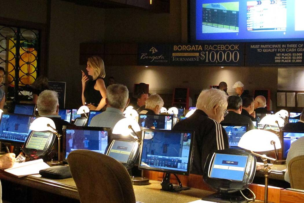 Bettors wait to make wagers on sporting events at the Borgata casino in Atlantic City, N.J., hours after it began accepting sports bets on June 14. (AP Photo/Wayne Parry, File)