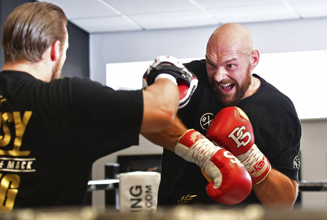 Tyson Fury spars in the ring during a workout at Hatton Health and Fitness, Hyde, England, Tuesday July 31, 2018. (Anthony Devlin/PA via AP)