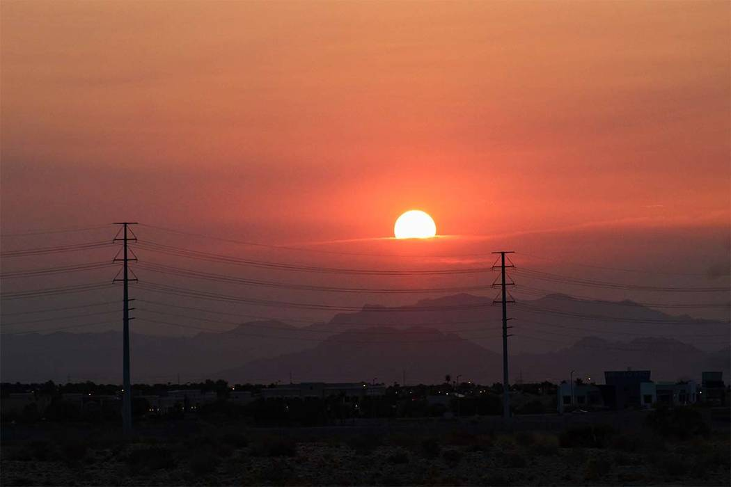 The sun rises over Summerlin on Friday, August 3, 2018. The Clark County Department of Air Quality has issued a smoke and ozone advisory for Friday as smoke from wildfires in California continues ...