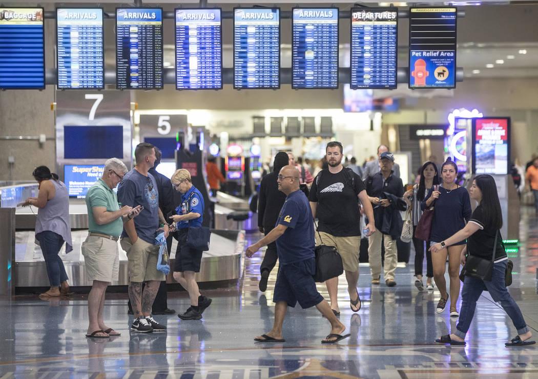 Passengers walk through Terminal 1 baggage claim at McCarran International Airport on Thursday, June 28, 2018, in Las Vegas. Benjamin Hager Las Vegas Review-Journal @benjaminhphoto