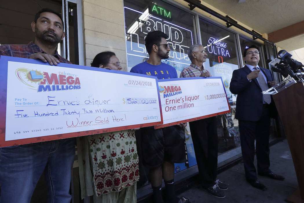 In this July 25, 2018 file photo, California Lottery deputy director of communications Russ Lopez, right, speaks during a news conference with Vishal Birly, from left, Kiran Sachdev, Amol Sachdev ...