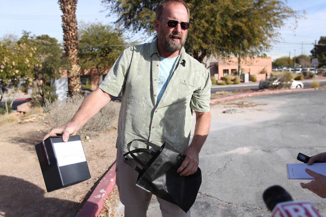 Eric Paddock, brother of Las Vegas gunman Stephen Paddock, shows the remains of his brother during an interview outside the Clark County coroner's office in Las Vegas on Jan. 18, 2018. K.M. Cannon ...