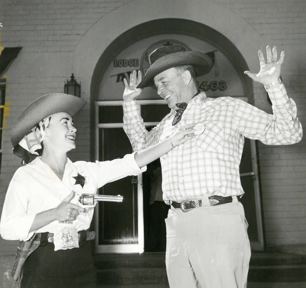 Margo Hines, Helldrado Beauty Queen, was commissioned a Kangaroo Kop by Elks Exalted ruler George Maxwell in May 1955 and makes a mock arrest of Lt. Gov. Rex Bell. (View file photo)