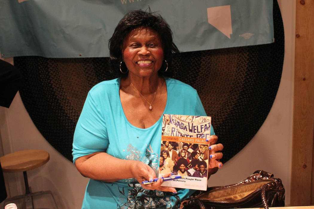 """Welfare rights organizer Ruby Duncan holds a copy of """"Storming Caesars Palace,"""" which chronicles her journey fighting for welfare reform locally. She spoke at The Writer's Block Sunday, March 13. ..."""