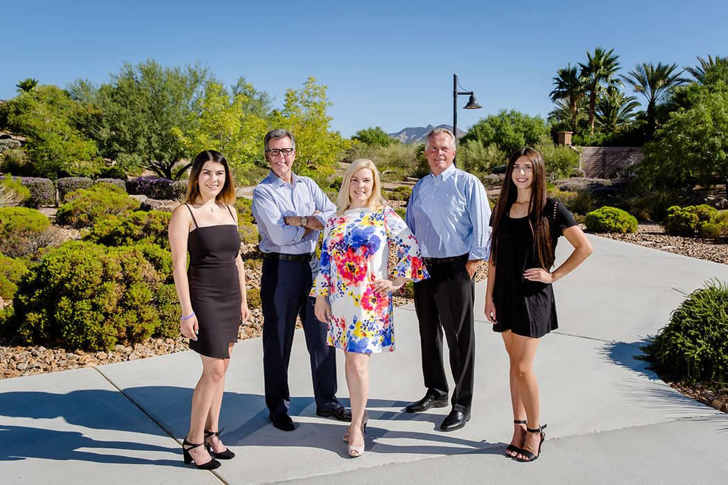 Howard Hughes Corp. executives join the 2018 Summerlin Children's Forum scholarship recipients. From left are Caitlyn Somers, Faith Lutheran High School; Tom Warden, senior vice president of com ...