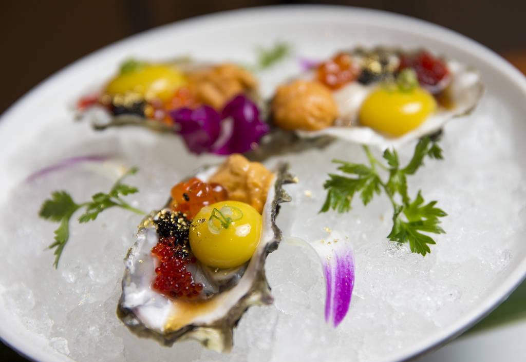 The Golden Eye appetizer, oysters, topped with uni, ikura, red and black tobiko, green onions and yuzu ponzu sauce, at the new Boathouse restaurant at Palace Station in Las Vegas on Friday, Aug. 3 ...