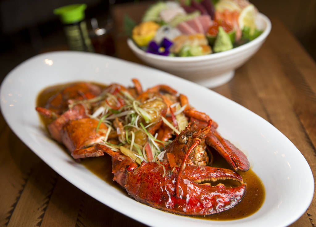 A wok-fired, whole lobster smothered in sweet ginger and scallion sauce at the new Boathouse restaurant at Palace Station in Las Vegas on Friday, Aug. 3, 2018. Richard Brian Las Vegas Review-Journ ...