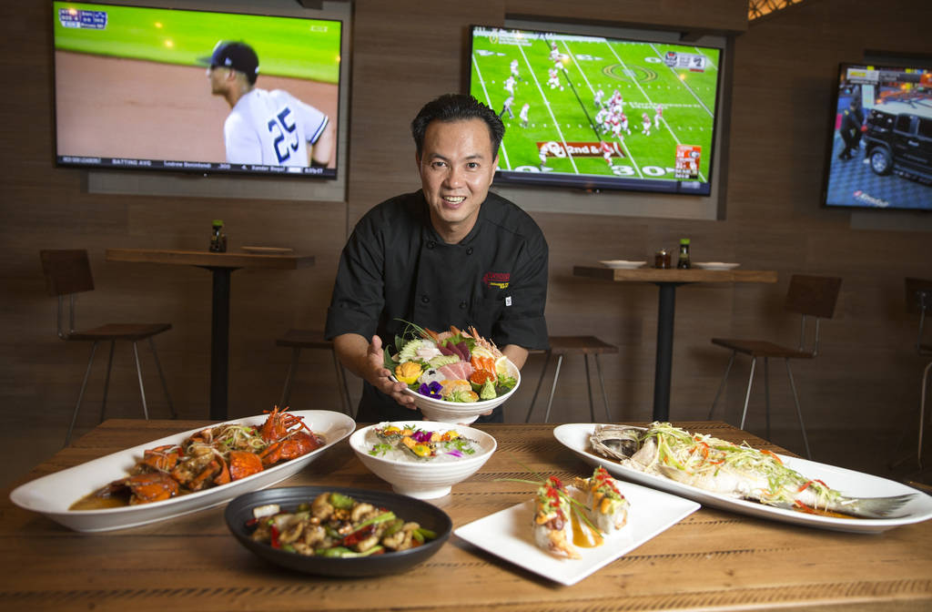 Tu Do, corporate executive chef and co-founder of Boathouse, poses with an assortment of his signature dishes at his new restaurant at Palace Station in Las Vegas on Friday, Aug. 3, 2018. Richard ...