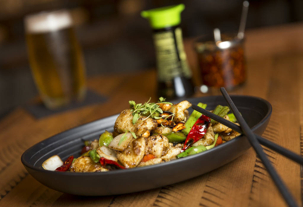 The Kicking Calamari dish, Chinese spiced calamari, peanuts, bell peppers, onions and dried chili pepper, at the new Boathouse restaurant at Palace Station in Las Vegas on Friday, Aug. 3, 2018. Ri ...