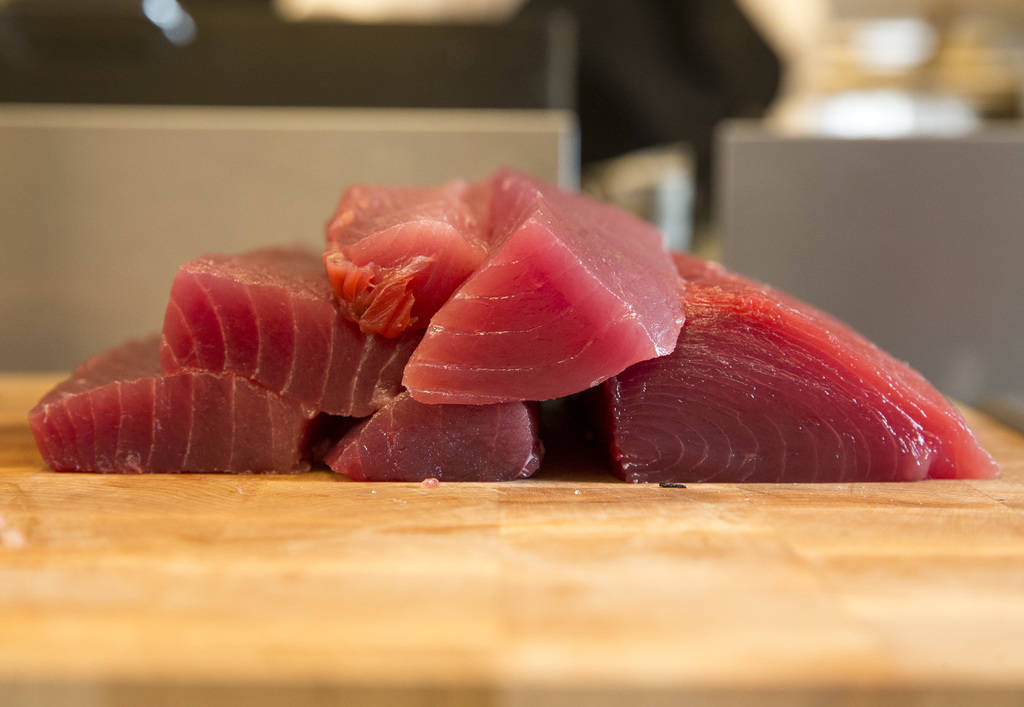 Ahi tuna for sashimi and nigiri is prepared by Japanese sushi chef Miho Akasaka in the kitchen at the new Boathouse restaurant at Palace Station in Las Vegas on Friday, Aug. 3, 2018. Richard Brian ...