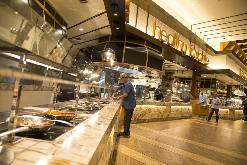 Bernie Navarro of Los Angeles loads up on stir-fry and beef at the new Feast Buffett at the newly renovated Palace Station hotel-casino in Las Vegas on Friday, Aug. 3, 2018. Richard Brian Las Vega ...