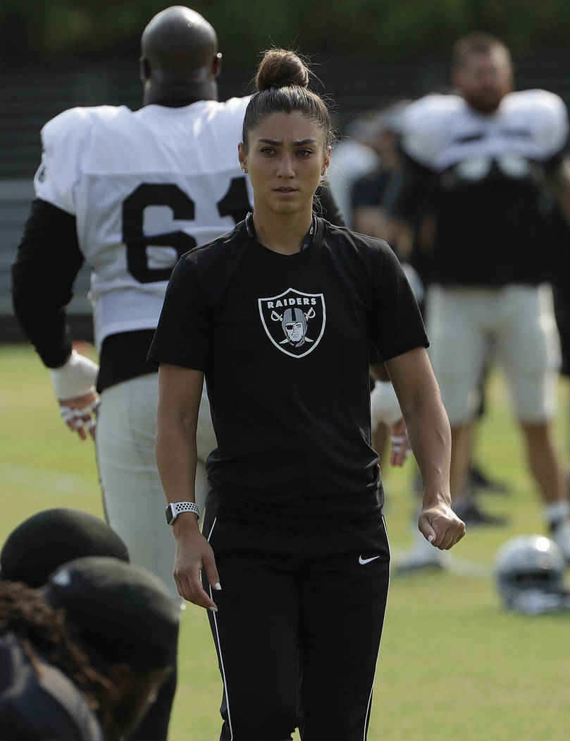 Oakland Radiers assistant Kelsey Martinez during NFL football practice in Napa, Calif., Wednesday, Aug. 1, 2018. (AP Photo/Jeff Chiu)