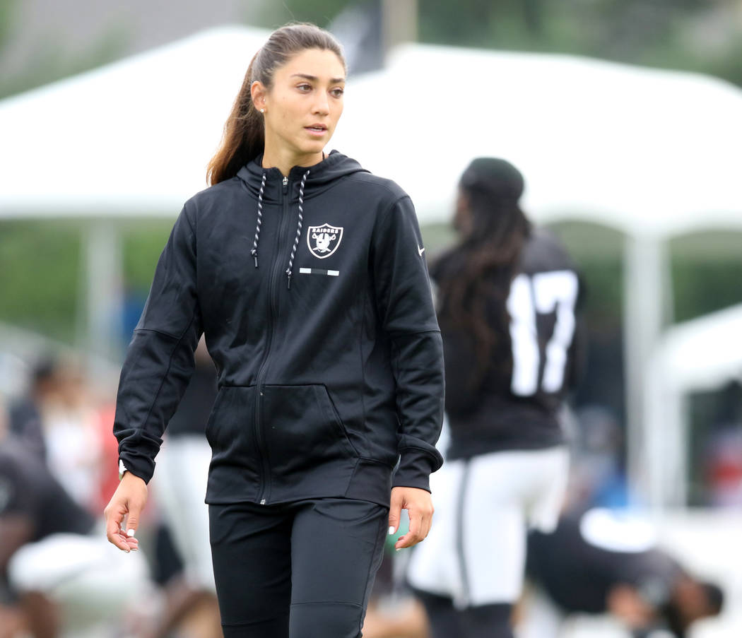 Oakland Raiders strength and conditioning assistant Kelsey Martinez oversees the warm up session at the team's NFL training camp in Napa, Calif., Wednesday, Aug. 8, 2018. Heidi Fang Las Vegas Revi ...